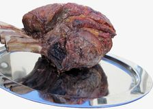Roasted Rib of beef. Joint of Beef waiting to be carved Royalty Free Stock Images