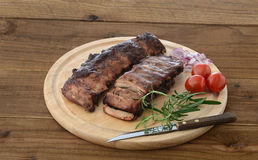 Roasted ribs on chopping board Royalty Free Stock Image