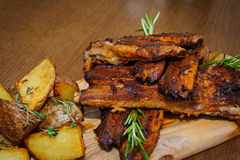 Roasted ribs with herbs Royalty Free Stock Image