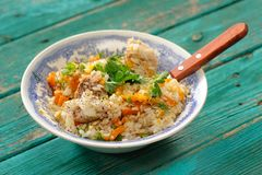 Roasted rice with meat, pumpking and fresh greens Stock Images
