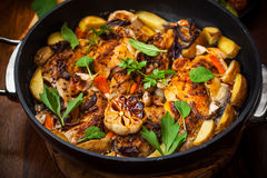 Roasted roasted rabbit. On vegetables in pan Royalty Free Stock Photo