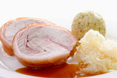 Roasted rolled roast, suckling pig, bread dumplings and sauerkra. Ut, close up stock photography