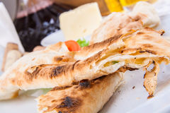 Roasted rolls of bread lavash filled with cheese Royalty Free Stock Photo