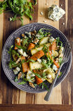 Roasted root and rocket salad Stock Images