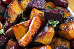 Roasted Root Vegetables. Root vegetables roasted with balsamic and thyme.  Includes beetroot, carrots, and sweet potato Stock Photo