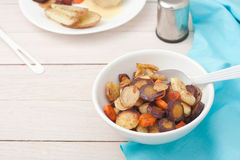 Roasted root vegetables: carrots, parsnips, sliced Royalty Free Stock Image