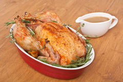 Roasted Rosemary Turkey in a dish with gravy Stock Image