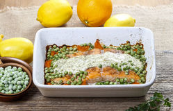 Roasted salmon with dill sauce and green peas. Royalty Free Stock Photos
