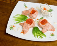 Roasted salmon filet with red caviar Royalty Free Stock Photography