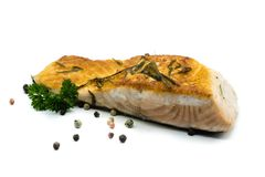Roasted salmon fillet garnished with peppercorns and parsley on white background royalty free stock images