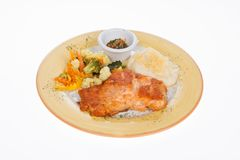 Roasted salmon fillet with vegetables and potato puree. On white background Royalty Free Stock Photos