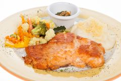 Roasted salmon fillet with vegetables and potato puree. On white background Stock Image