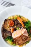 Roasted Salmon Fillet with Vegetables on Rustic White Plate. Healthy Food Concept stock photo