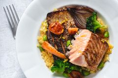 Roasted Salmon Fillet with Vegetables on Rustic White Plate. Healthy Food Concept royalty free stock image