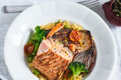 Roasted Salmon Fillet with Vegetables on Rustic White Plate. Healthy Food Concept stock images