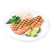 Roasted salmon fillets with rice. Royalty Free Stock Photo