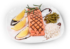 Roasted salmon fillets with rice. Royalty Free Stock Images
