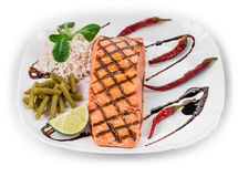 Roasted salmon fillets with rice. Royalty Free Stock Photography