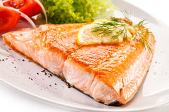 Roasted salmon. Fish dish - roasted salmon and vegetables Stock Image