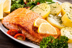 Roasted salmon. Fish dish - roasted salmon and vegetables Stock Photo