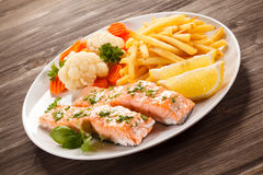 Roasted salmon with french fries Stock Photos