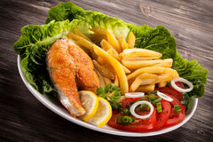 Roasted salmon with french fries Royalty Free Stock Images