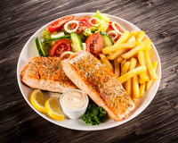 Roasted salmon with french fries Royalty Free Stock Photography