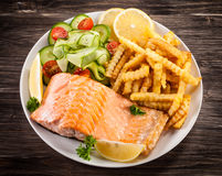 Roasted salmon with french fries Stock Images