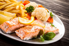 Roasted salmon with french fries Royalty Free Stock Image