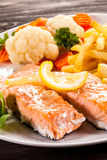 Roasted salmon with french fries Royalty Free Stock Photos