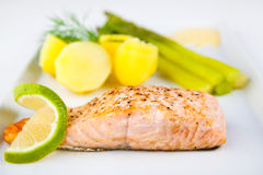 Roasted salmon with green asparagus and potatoes Stock Photo