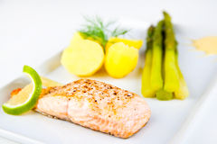Roasted salmon with green asparagus and potatoes Royalty Free Stock Image