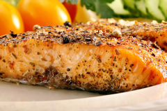 Roasted salmon with herbs and vegetables Royalty Free Stock Image