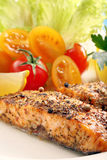 Roasted salmon with herbs and vegetables.  Royalty Free Stock Photos