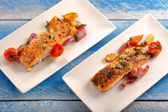 Roasted salmon with herbs and vegetables.  Stock Image