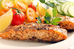 Roasted salmon with herbs and vegetables. Rosted salmon with herbs and vegetables Royalty Free Stock Photography