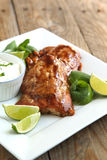 Roasted salmon with hoisin glaze. Served on plate with yogourt sauce, lime and mint stock photos