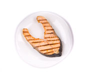 Roasted salmon on a plate Royalty Free Stock Photography