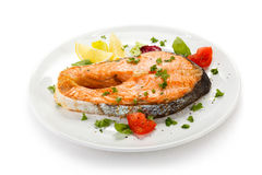 Roasted salmon with potatoes Royalty Free Stock Images