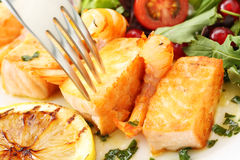 Roasted salmon and shrimps with fresh  salad Stock Photo