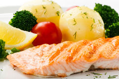 Roasted salmon and vegetables Stock Photos