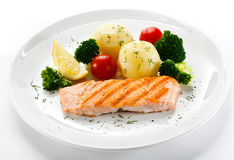Roasted salmon and vegetables Stock Photography