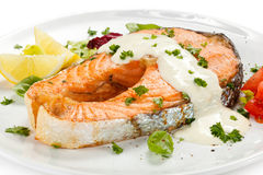 Roasted salmon and vegetables Royalty Free Stock Images