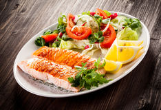 Roasted salmon and vegetables Stock Images