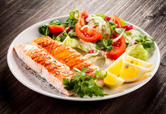 Roasted salmon and vegetables Royalty Free Stock Photo