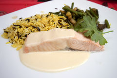 Roasted salmon with yellow rice. And vegetables stock images