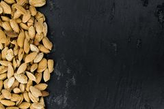 Roasted and salted Almonds with shell. On a vintage background close-up shot Stock Photography