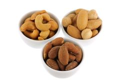 Roasted and salted Cashew nuts, Brazil nuts and Almonds Stock Photo