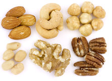 Assortment of Mixed nuts on white background. An assortment of roasted and salted mixed nuts on a white background Stock Images