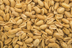 Roasted salted peanuts background. This background of peanuts shows a healthy and wholesome snack food product that is eaten in many diets or with a meal Stock Photo